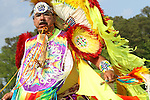 A Native American man dances in full traditional regalia at the 8th Annual Red Wing PowWow in Virginia Beach, Virginia.
