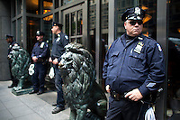 NEW YORK, NY - MAY 01: Police officers guard a restaurant during a march as part of May Day rallies on May 1, 2013 in New York City. Rallies and marches are occuring throughout the city today to mark the day which is traditionally associated with workers movements. (Photo by Kena Betancur).