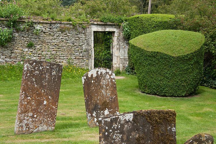 Box topiary in the graveyard of St Leonard & St James Church, Rousham House and Garden.