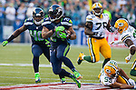 Seattle Seahawks running back Marshawn Lynch (24) rushes for a 21-yard gain against the Green Bay Packers  in the NFL Kickoff held at CenturyLink Field in September 4, 2014 in Seattle.      Seattle beat Green Bay 36-16. ©2014  Lynch rushed for 110 yards and score two touchdown as  Seattle beat Green Bay 36-16. ©2014  Jim Bryant Photo. ALL RIGHTS RESERVED.