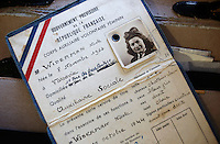 NWA Media/DAVID GOTTSCHALK - 10/6/14 - Nicole Holland, a Springdale resident, displays her identification issued in October of 1944 during WWII Monday October 6, 2014 inside her Springdale home. Her daughter, Brenda Hancock, has written a book about her and the experiences she had as a French Jew in the French Underground during WWII.