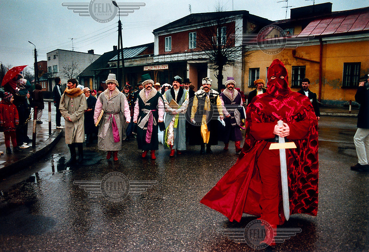 """The Hangman leads the procession. The """"Decapitation of Death"""" takes place in the small town of Jedlinsk, in central Poland, every year on the Tuesday before Lent (Shrove Tuesday). Its exact origins are unclear, but it is believed to have begun in the 16th Century, and was first written by the local rector in 1839. The whole town gets involved in the theatrical pageant, and the words uttered by the main players, the Bride, Angel, Jew, Hangman, Devil and Bartholomew the Policeman, are well known among locals. It is believed that on this day Death gets drunk and loses its scythe, offering the perfect opportunity for him to be arrested and executed. After calls from the crowd, Death is sentenced to death, and a grand feast, marking the beginning of Lent, can begin."""