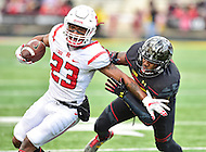 College Park, MD - NOV 26, 2016: Rutgers Scarlet Knights wide receiver Dacoven Bailey (23) breaks the tackle of Maryland Terrapins linebacker Jermaine Carter Jr. (23) during game between Maryland and Rutgers at Capital One Field at Maryland Stadium in College Park, MD. Maryland defeated Rutgers 31-13. (Photo by Phil Peters/Media Images International)