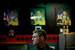 U2 pilot Maj. Eric Shontz sits at a bar while portraits of pilots who died while flying the U2 line the wall behind him in the U2 pilots' &quot;Heritage Room&quot; at Beale Air Force Base February 23, 2010 in Linda, Calif.