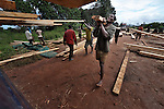 Men load lumber on a truck at a logging operation in central Malawi.