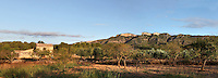Traditionnal farming house surrounded by almond trees and olive trees at the feet of rocky hills, Ribera d'Ebre (Ebro), Tarragona, Spain. Picture by Manuel Cohen
