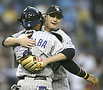 Colorado Rockies' pitcher Josh Fogg hugs his catcher Yorvit Torrealba after they beat the Seattle Mariners 2-0 in Seattle on June 30, 2006.Jim Bryant Photo. ©2010. ALL RIGHTS RESERVED.