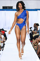 Model walks runway in a Fabric Twinz swimsuit by Tanise Francis during the JRG Bikini Under The Bridge 2012 fashion show on July 9, 2012.