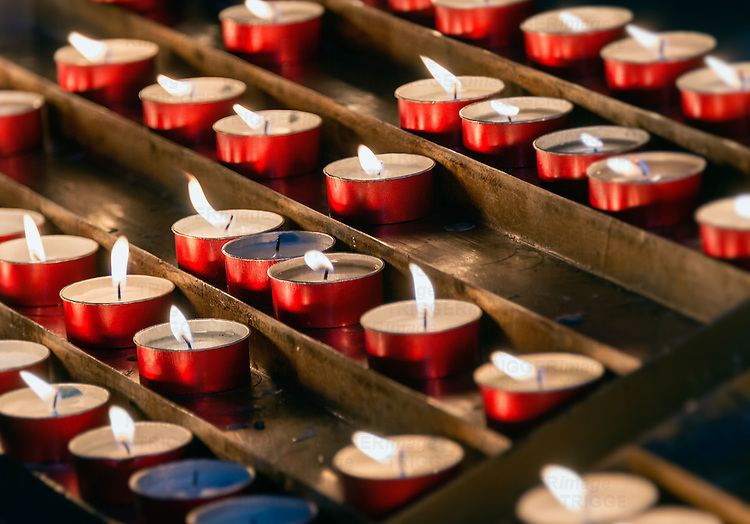 Devotional prayer candles in a Catholic church.