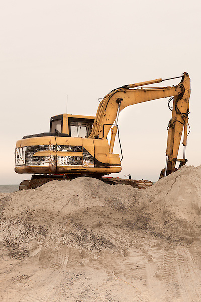 February 25, 2013. Rodanthe, North Carolina. An earthmover sits at rest on the Outer Banks, the barrier islands of North Carolina. As the beach on the islands deteriorates, residents replenish their own beaches with sand from offshore.. Tracing the path of Hurricane Sandy, which wrecked havoc on the northeastern seaboard from October 25-31, 2012. The storm caused flooding and caused an estimated 60 billion dollars worth of damage to affected areas.