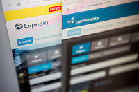 The Expedia and Travelocity websites are seen on a computer screen on Friday, January 23, 2015.  Expedia has purchased its competitor, Travelocity for $280 million. Travelocity has been using Expedia's search engine in a marketing agreement dating to 2013, hence the similarities in design and apparently the search results. (© Richard B. Levine)