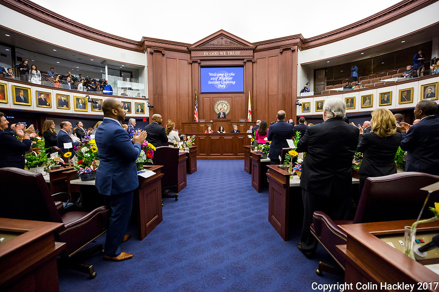 TALLAHASSEE, FLA. 3/7/17-Senate President Joe Negron, R-Stuart, joins his colleagues as they greet a guest during opening day of the legislative session at the Capitol in Tallahassee.<br /> <br /> COLIN HACKLEY PHOTO