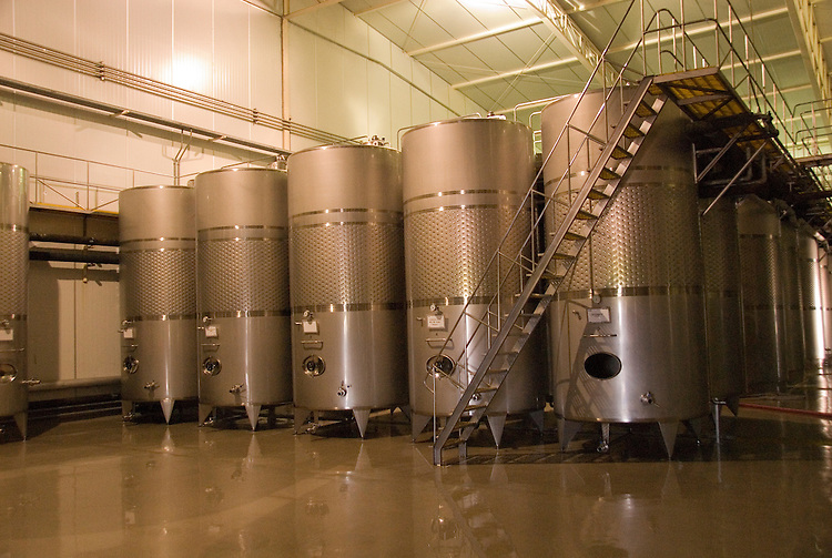 Chile Wine Country: Stainless steel tanks for storing wine at Undurraga Winery, Vina Undurraga, near Santiago..Photo #: ch428-32830..Photo copyright Lee Foster, 510-549-2202, www.fostertravel.com, lee@fostertravel.com.