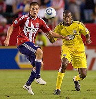 Chivas USA forward Justin Braun (17) battles Columbus Crew defender Andy Iro (6). CD Chivas USA defeated the Columbus Crew 3-1 at Home Depot Center stadium in Carson, California on Saturday July 31, 2010.