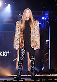 Male model wearing a fur coat for the Roxanne Nikki fall fashion show