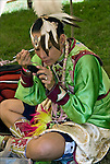 "Native American getting ready putting on make-up for Thunderbird Pow Wow Grand Entry at the Queens County Farm Museum ....A pow-wow (also powwow or pow wow or pau wau) is a gathering of North America's Native people. The word derives from the Narragansett word powwaw, meaning ""spiritual leader""."