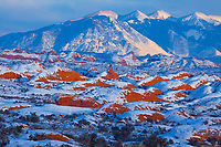 Petrified dunes with heavy snow  Arches National Park, Utah    La Sal Mountains beyond December Sandstone domes
