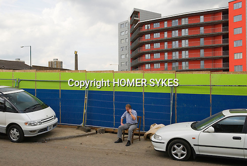 East London Lea Valley  site of the 2012 Olympic Games village and arena,   Stratford, England 2007. Man on mobile phone Iceland Road E3.