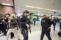 NYPD Emergency Services officers after hundreds of people stampede out of Penn Station in New York on Friday, April 14, 2017 after an unfounded active shooter report.  (© Richard B. Levine)