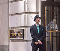 A doorman welcomes customers to the Tiffany & Co. Wall Street store in Lower Manhattan in New York on Friday, July 3, 2015. (© Richard B. Levine)