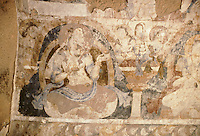 Fresco on the top head of the 54 meters Bamiyan Buddha. four Kalashnikov bullet impact, soot by Soldiers of warlord Ahmad Shah Massoud, who occupied militarily the cliff during 1995 to 96, damage the fresco. During the Taliban occupation between 1996 to 1999, the fresco received two more Kalashnikov bullet impact. Hazarajat, Afghanistan..The entire niche was once covered with paintings dating from i he late 5th to the early 7th centuries. Only a few remain and even these continue to crumble and flake off as the years go by..The scene is Paradise. Buddha and Bodhisattva figures sit on massive curtained thrones, not in the rigid yoga pose as in the row below, but gracefully and nonchalantly, with their feet crossed at the ankle. They do not wear monastic robes but flowing scarfs and jewelled necklaces instead. Between them there are pennanted stupas and capitalled columns from which rise bare busted female musicians playing cymbals for their dancer companions..