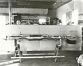 Henry Sachs, machinist, is shown with Doctor Robert H. Goddard's rocket used in the first flight at Roswell, New Mexico on December 30, 1930. The rocket attained an altitude of about 2,000 feet and speed of about 500 miles per hour. In 1930, with a grant from the Guggenheim Foundation, Goddard and his crew moved from Massachusetts to Roswell, New Mexico, to conduct research and test flights. This rocket was one of many that he launched in Roswell from 1930 to 1932 and from 1934 to 1941. Doctor Goddard has been recognized as the father of American rocketry and as one of the pioneers in the theoretical exploration of space. His dream was the conquest of the upper atmosphere and ultimately space through the use of rocket propulsion. When the United States began to prepare for the conquest of space in the 1950's, American rocket scientists began to recognize the debt owed to the New England professor. They discovered that it was virtually impossible to construct a rocket or launch a satellite without acknowledging the work of Doctor Goddard. .Credit: NASA via CNP