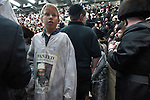"A kid dressed-up with a ""Wanted"" poster of Osama Bin-Laden as Ultra-Orthodox Hassidic Jews celebrate the holiday of Purim in the city of Beit Shemesh, close to Jerusalem, Israel."