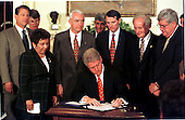 United States President Bill Clinton signs the Drug-Free Communities Act of 1997 at the White House in Washington, D.C. on June 27, 1997. Standing behind the President, left to right, U.S. Vice President Al Gore, U.S. Attorney General Janet Reno, U.S. Secretary of Health and Human Services (HHS) Donna Shalala, General Barry McCaffrey, U.S. Secretary of the Treasury Robert Rubin, U.S. Representative Rob Portman (Republican of Ohio), U.S. Representative Sandy Levin (Democrat of Michigan), and U.S. Representative Dennis Hastert (Republican of Illinois)..Credit: Ron Sachs / CNP.
