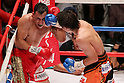(L to R)  Hugo Cazares (Mex), Tomonobu Shimizu (JPN),AUGUST 31, 2011 - Boxing : Tomonobu Shimizu of Japan hits Hugo Cazares of Mexico during the WBA Super fly weight title bout at Nippon Budokan, Tokyo, Japan. Tomonobu Shimizu of Japan won the fight on points after twelve rounds. (Photo by Yusuke Nakanishi/AFLO SPORT) [1090]