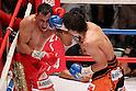 (L to R)  Hugo Cazares (Mex), Tomonobu Shimizu (JPN),AUGUST 31, 2011 - Boxing : Tomonobu Shimizu of Japan hits Hugo Cazares of Mexico during the WBA Super fly weight title bout at Nippon Budokan, Tokyo, Japan. Tomonobu Shimizu of Japan won the fight on points after twelve rounds. (Photo by Yusuke Nakanishi/AFLO SPORT) [1090]
