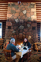 Diners enjoy a fireside table at the Keweenaw Mountain Lodge in Copper Harbor Michigan in winter.