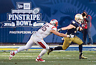 Dec. 28, 2013; Running back Cam McDaniel (33) carries in the third quarter of the Pinstripe Bowl in Yankee Stadium.<br /> <br /> Photo by Matt Cashore