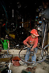 Asad Ullah, 9, works in his father's bike shop in Kabul, Afghanistan. The shop earns about $4-6 USD per day.