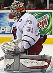 1/07/05 Omaha, Neb. University of  Nebraska at Omaha goalie Chris Holt stops a Northern Michigan while NMU was on a power play during the third period Friday night in Qwest Center Omaha. (photo by chris machian/Prarie Pixel Group)