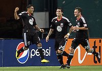 Stephen King #20 and Santino Quaranta #25 of D.C. United rush to congratulate goalscorer Andy Najar #14 during an MLS match against the Los Angeles Galaxy at RFK Stadium on July 18 2010, in Washington D.C. Galaxy won 2-1.