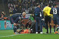 U.S. national team medical staff attend to Tim Howard after the goalkeeper's hard collision with England forward Emile Heskey. The U.S. and England played to a 1-1 draw in the opening match of Group C play at Rustenburg's Royal Bafokeng Stadium, Saturday, June 12th.