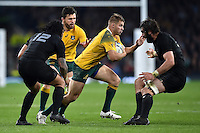 Drew Mitchell of Australia takes on the New Zealand defence. Rugby World Cup Final between New Zealand and Australia on October 31, 2015 at Twickenham Stadium in London, England. Photo by: Patrick Khachfe / Onside Images