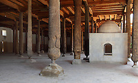 General view of Prayer Hall, with shrine, Juma Mosque, Khiva, Uzbekistan, pictured on July 6, 2010, in the morning. The Juma Mosque, Khiva's main Friday Mosque is, unusally, a single storey building, whose 18th century architects tried to preserve the characteristics of its 10th century predecessor. The 45x55 metre prayer hall contains 212 10th-18th century pillars of varying form and decoration. Some are from the ancient mosque on the same site, others are battle trophies. They are remarkable not only for their fine carving and decoration but also for the  design of the lower sections in the form of a vase with flowering shoots. Khiva, ancient and remote, is the most intact Silk Road city. Ichan Kala, its old town, was the first site in Uzbekistan to become a World Heritage Site(1991). Picture by Manuel Cohen.