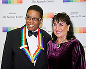 2013 Kennedy Center Honor recipient Herbie Hancock and his wife, Gigi, arrives for the formal Artist's Dinner honoring the recipients of the 39th Annual Kennedy Center Honors hosted by United States Secretary of State John F. Kerry at the U.S. Department of State in Washington, D.C. on Saturday, December 3, 2016. The 2016 honorees are: Argentine pianist Martha Argerich; rock band the Eagles; screen and stage actor Al Pacino; gospel and blues singer Mavis Staples; and musician James Taylor.<br /> Credit: Ron Sachs / Pool via CNP