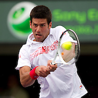 Novak DJOKOVIC (SRB) aganst Olivier ROCHUS (BEL) in the second round of the men's singles. Rochus beat Djokovic 6-2 6-7 6-4..International Tennis - 2010 ATP World Tour - Sony Ericsson Open - Crandon Park Tennis Center - Key Biscayne - Miami - Florida - USA - Fri 26 Mar 2010..© Frey - Amn Images, Level 1, Barry House, 20-22 Worple Road, London, SW19 4DH, UK .Tel - +44 20 8947 0100.Fax -+44 20 8947 0117