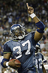 Seattle Seahawks' running back Shaun Alexander waves to the crowd after scoring his fifth touchdown in the first half against, an NFL record, against the Minnesota Vikings on Sunday, Sept., 29, 2002 at Seattle's Seahawk Stadium. jim Bryant Photo