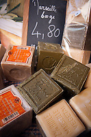 Briancon, Hautes Alpes, France, July 2013. Olive oil soap. The walled city of Briancon is full of narrow streets filled with medieval houses and many shops, restaurants and bars. The Hautes Alpes region is made of valleys, lakes, canyons and mountains going from the northern Alps to the Provence and ranges from 500m to 4302m  in altitude. Endowed with an exceptional beauty the Hautes Alpes has managed to keep clear of industry and large crowds. The atmosphere has stayed casual and convivial. There is an alpine feeling in this area due to its steep slopes and the abundance of mountain villages. Photo by Frits Meyst/Adventure4ever.com