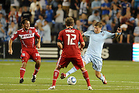 Luke Sassano (32) Sporting KC,Gaston Puerari (18), Logan Pause (12) Chicago Fire...Sporting KC were held to a scoreless tie with Chicago Fire in the inauguarl game at LIVESTRONG Sporting Park, Kansas City, Kansas.