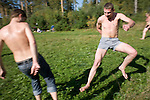 Patients in a rehabilitation program for heroin addiction operated by the NGO Rosa Vetrov play soccer in Kazan, Russia, on Wednesday, September 26, 2007. The dozen patients in the free three-month program take a weekly field trip to a nearby lake, where they learn play soccer, have group therapy sessions, and generally learn how to relax and have fun without using drugs.