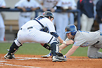 Ole Miss' Miles Hamblin (24) tags out Memphis' Phillip Chapman (11) at Oxford University Stadium in Oxford, Miss. on Tuesday, February 22, 2011.