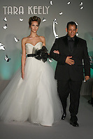 Fashion designer Lazaro Perez walks runway with model, at the close of the Tara Keely Fall 2011 fashion show, at JLM Couture.