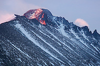 &quot;THE SENTINEL&quot; - Longs Peak catches the last rays of a stormy winter sunset.
