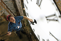 Wes McEachron, an instrument maker in the UW-Madison machine shop, has helped maintain the Music Hall clock since 1988. The clock was installed in the clocktower of what was then called Assembly Hall in 1879, and remains gravity-run 125 years later.<br /> <br /> Client: University of Wisconsin-Madison<br /> &copy; UW-Madison University Communications 608-262-0067<br /> Photo by: Michael Forster Rothbart<br /> Date:  5/04    File#:   D100 digital camera frame 4494.