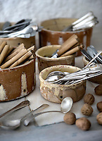 In the kitchen cutlery is stored in old earthenware bowls