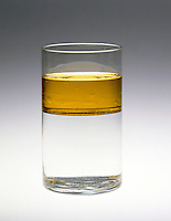 IMMISCIBILITY: OIL AND WATER SEPARATION (2 of 2) <br /> In Glass Cylinder<br /> The inability of two or more substances or liquids to readily dissolve into one another, such as oil and water.